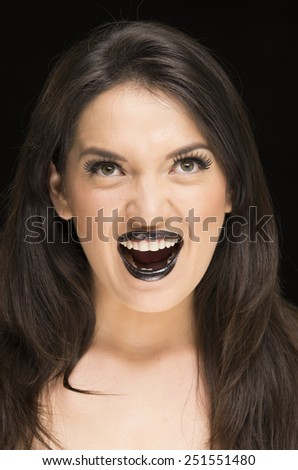 closeup portrait of scary young woman wearing goth makeup