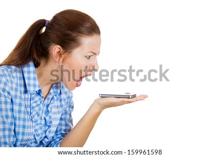 Closeup portrait of screaming, angry, young woman on the mobile phone, isolated on white background with copy space. Negative human emotions and facial expressions. Communication, conflict resolution - stock photo