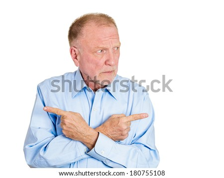 Closeup portrait of senior confused mature man, pointing two different directions, not sure which way to go in life, isolated white background. Negative emotions, facial expressions, feelings, dilemma - stock photo