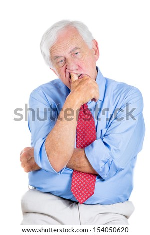 Closeup portrait of senior elderly mature man trying to remember something in deep thought, looking up and daydreaming, sucking up his thumb, isolated on white background with copy space - stock photo
