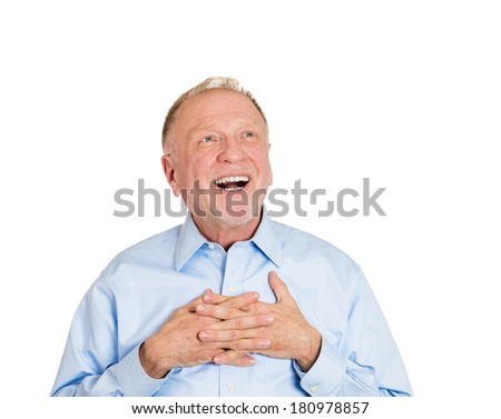 Closeup portrait of senior elderly mature man with smile on face, in love looking up, hands on chest thinking, good memories of past, daydreaming isolated white background. Human emotions, expressions