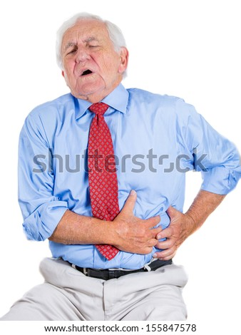 Closeup portrait of senior executive, old man, elderly corporate employee, grandfather looking miserable, very sick, doubling over in stomach, spleen pain, isolated on white background. Heart attack.