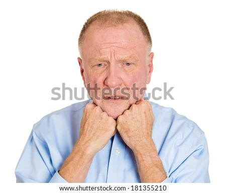 Closeup portrait of senior mature depressed man really sad, deep in thought, realizing truth looking down, chin on fists, isolated on white background. Human face expression emotion feeling, reaction - stock photo