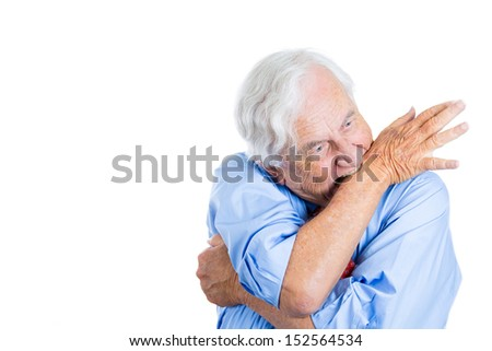 Closeup portrait of senior mature, elderly man very nervous, crazy, stressed, and biting his arm, isolated on white background with copy space - stock photo