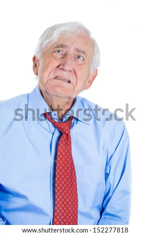 Closeup portrait of senior mature, elderly man very sad and depressed and almost to the point of crying, isolated on white background - stock photo