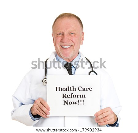 Closeup portrait of senior mature health care professional, doctor, nurse, with stethoscope hold health care reform now ! sign, isolated on white background. Government, politics, insurance debate - stock photo