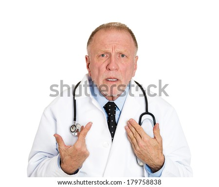 Closeup portrait of senior mature health care professional, old doctor with stethoscope, asking you mean me? looking confused, isolated on white background. Negative emotion facial expression feeling.