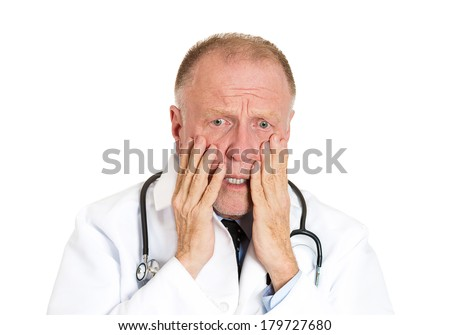 Closeup portrait of senior mature health care professional, stressed, overwhelmed doctor, nurse, with stethoscope, isolated on white background. Negative human emotions, facial expression feelings. - stock photo