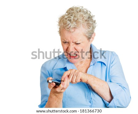 Closeup portrait of senior mature mad angry woman yelling while on a phone isolated on white background. Negative human emotions, facial expressions, feelings. Communication, conflict resolution - stock photo