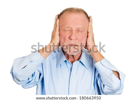 Closeup portrait of senior mature, peaceful, tranquil, looking relaxed, business man covering his ears, closed eyes, isolated white background. Hear no evil concept. Human emotion, facial expressions