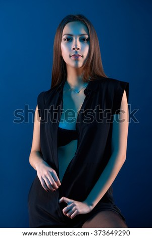 Closeup portrait of sensual beauty woman posing in black shirt showing her ample cleavage - stock photo
