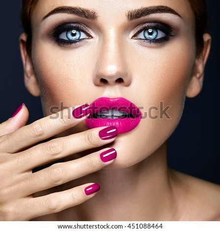 closeup portrait of sensual glamour beautiful woman model lady with fresh daily makeup and clean healthy skin face touching her pink lips