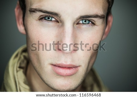 Closeup portrait of sensual man with beautiful face and eyes. - stock photo