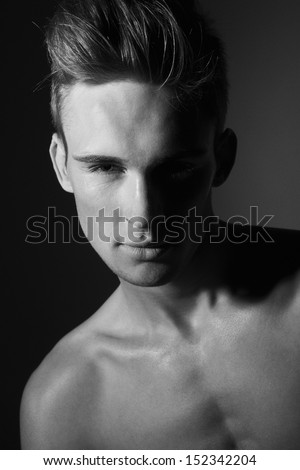 Closeup portrait of sensual man with beautiful face and eyes in black and white - stock photo