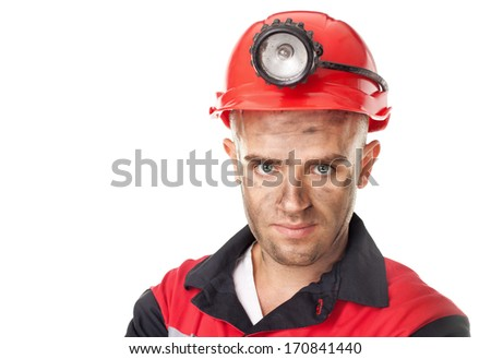 Closeup portrait of serious coal miner isolated on white background - stock photo