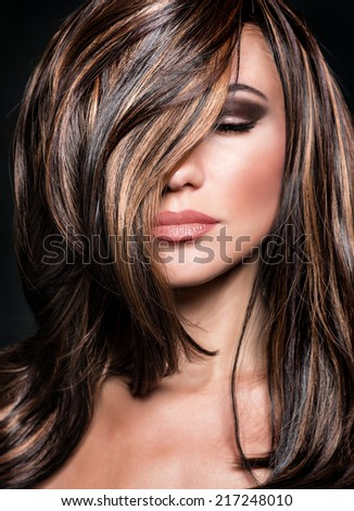 Closeup portrait of sexy girl with closed eyes and perfect dark makeup and shiny hair, fashionable professional model, beauty salon concept