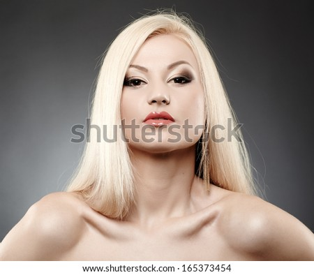Closeup portrait of sexy glamorous blonde over gray background