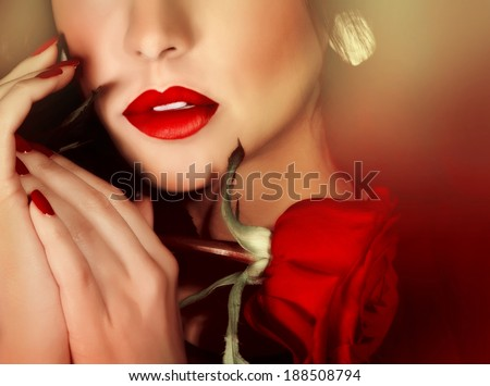 Closeup portrait of sexy gorgeous woman with red lipstick and red rose, half face, luxury beauty salon, seduction concept  - stock photo
