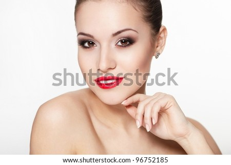 closeup portrait of sexy smiling caucasian young woman model with glamour red lips,bright makeup, eye arrow makeup, purity complexion. Perfect clean skin.white teeth - stock photo