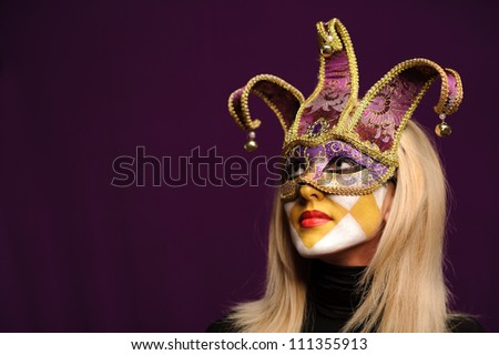 closeup portrait of sexy woman in violet party mask