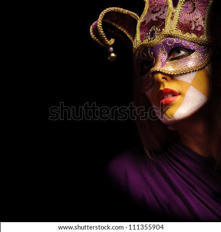 closeup portrait of sexy woman in violet party mask for desire and christmas concept