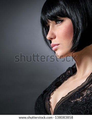 Closeup portrait of sexy woman with stylish short haircut isolated on dark background, profile of seductive brunette female with perfect makeup, beauty salon - stock photo