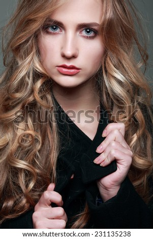 Closeup portrait of sexy  young woman with beautiful blue eyes on grey background - stock photo