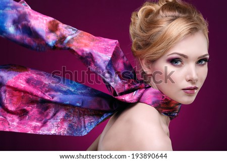 Closeup portrait of sexy  young woman with beautiful blue eyes on violet background - stock photo