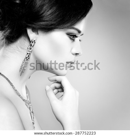 Closeup portrait of sexy  young woman with beautiful green eyes on  a light - grey background