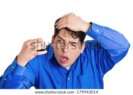 Closeup portrait of shocked funny looking guy, business man feeling head, surprised he is losing hair receding hairline, upset isolated on white background. Negative facial expression emotion feeling - stock photo