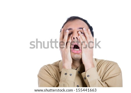 Closeup portrait of shocked, horrified, handsome worried and stressed guy with hands on face, isolated on white background