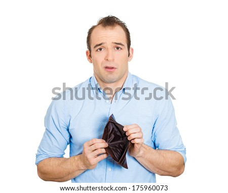 Closeup portrait of shocked puzzled sad unhappy business man worker employee, funny looking guy, student holding empty wallet isolated on white background. Bankruptcy financial difficulty. Expressions