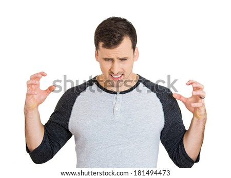 Closeup portrait of shocked, sad, worried, stressed young man, hands in air looking down, isolated white background. Negative facial expressions, emotions, feelings, reaction, perception of situation
