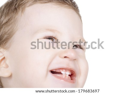 Closeup portrait of smiling cute baby looking away isolated on white background