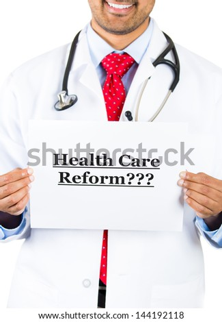 """Closeup portrait of smiling health care professional with red tie and stethoscope holding up a sign which says """"Health Care Reform???"""", isolated on white background - stock photo"""