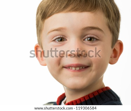 Closeup portrait of smiling young brunette caucasian boy with bangs - stock photo