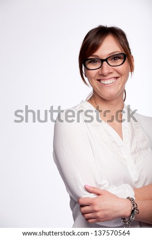 Closeup portrait of smiling young woman wearing glasses isolated on glaucous background