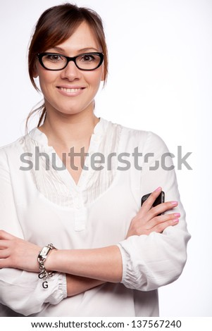 Closeup portrait of smiling young woman wearing glasses isolated on white background