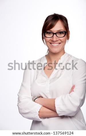 Closeup portrait of smiling young woman wearing glasses isolated on white background - stock photo