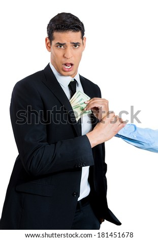Closeup portrait of someone arm happily stealing money from a shocked and surprised business man, isolated on white background. Financial greed concept. Is your agent taking too much money? - stock photo