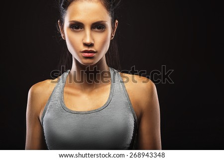 closeup portrait of sporty beautiful brunette woman - stock photo