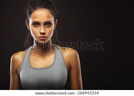 closeup portrait of sporty beautiful brunette woman