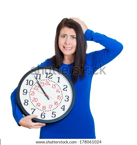 Closeup portrait of stress business woman, student running late with clock under arm. Concept photo with young employee anxious as project deadline, finals approaching, isolated on white background. - stock photo