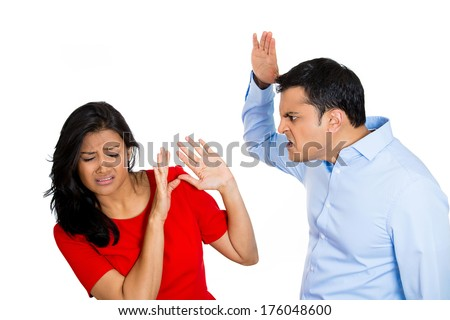 Closeup portrait of stressed, arguing young couple having serious problems fighting, isolated on white background .Woman victim of domestic violence and abuse. Husband man about to beat his wife - stock photo