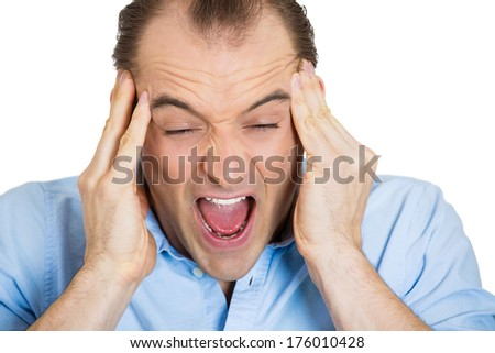 Closeup portrait of stressed business man, overwhelmed student, upset mad employee having bad headache, pressured by lack of time, boss, project family life isolated on white background. Human emotion - stock photo