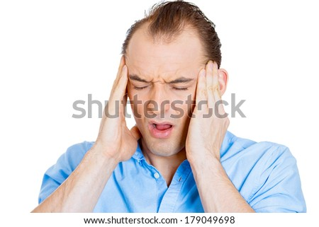 Closeup portrait of stressed business man, overwhelmed student, upset mad employee having headache, pressured by lack of time, boss, project, family life isolated on white background. Human emotion