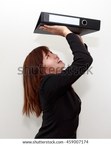 Closeup portrait of stressed or unhappy businesswoman shoulder heavy papers folder, hard work business concept - stock photo