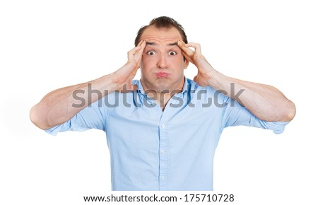 Closeup portrait of stressed out young funny looking man, trying to find solution, escape from problem, having bad day, headache isolated on white background. Negative human emotion, facial expression - stock photo