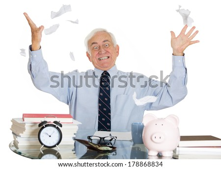 Closeup portrait of stressed, overwhelmed, sad elderly business man, broker, bank worker troubled by budget numbers, unhappy with contract, tossing shredded papers in air, isolated white background - stock photo