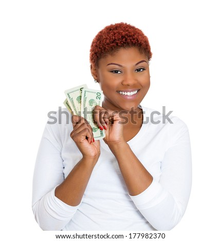 Closeup portrait of super happy excited successful young business woman holding money dollar bills in hand, isolated on white background. Positive emotions, facial expression feeling. Financial reward - stock photo